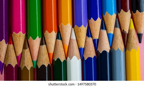 multi-colored pencils in a set lie against each other. Web banner, for your design.