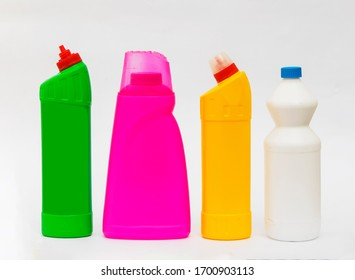 multicolored plastic bottles with household for chemicals on a white background