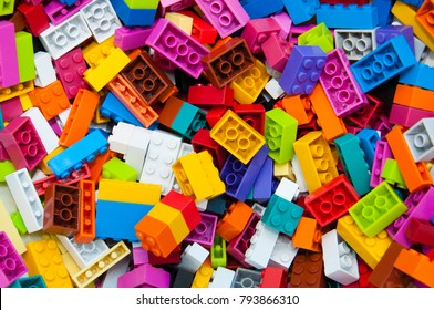 Multicolored plastic building blocks of the designer. Background of bright plastic building blocks.