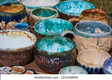 Multi-colored pottery pottery, bowls, cups covered with blue blue and brown glaze.