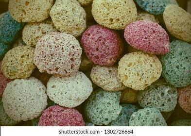 Multicolored pumice stones close up at traditional arabian bazaar.