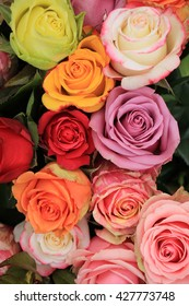 Multicolored roses in a colorful wedding arrangement