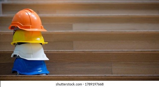 Multicolored Safety Construction Worker Hats. Teamwork of the construction team must have quality. Whether it is engineering, construction worker. Have a helmet to wear at work. For safety at work.