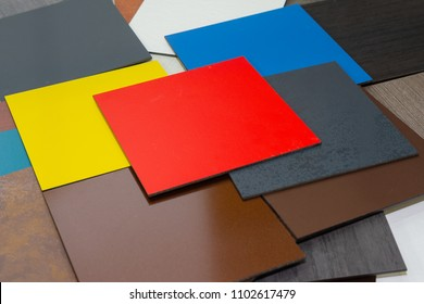 Multi-colored samples of composite materials for the ventilated facades in showroom. Construction