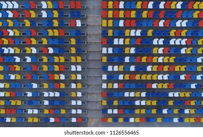 Multicolored seating in the stadium, view from the sky. Aerial photography, background.