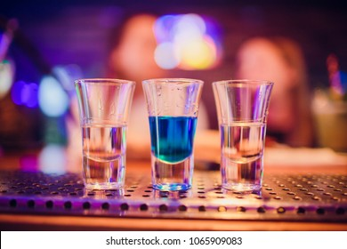 Multicolored shots on bar