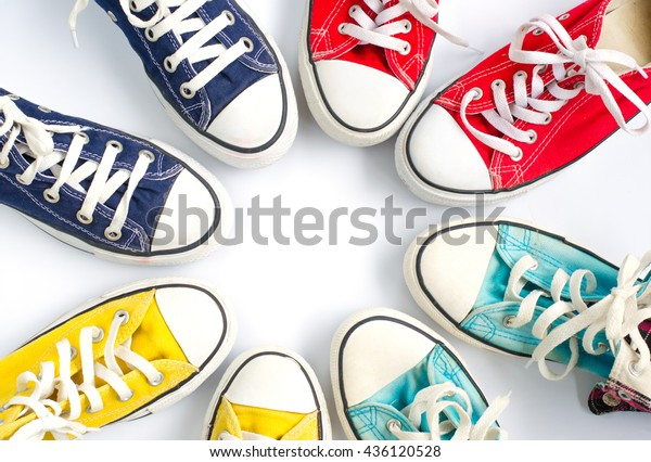 Multicolored sneakers on white background