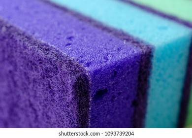 Multi-colored sponges for washing dishes. Bright abstract background.