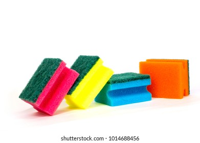 multicolored sponges for washing dishes on white background