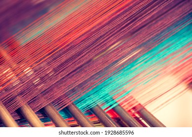 Multicolored straight strands texture background, sewing equipment, loom equipment at a garment factory - Shutterstock ID 1928685596