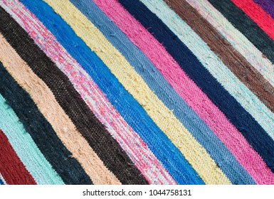 multi-colored striped rug.texture of multi-colored striped rug made by hands