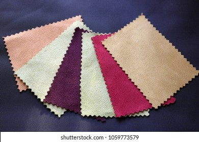 Multi-colored suede flaps on a black background
