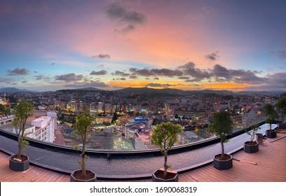 Multi-colored sunset over the city of Da Lat, Vietnam - Shutterstock ID 1690068319