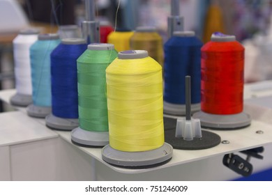 Multicolored threads on the sewing machine close-up. Industry