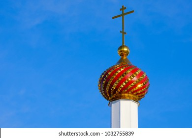 a multi-colored tower of the Orthodox Church in the Russian outback