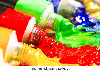Multicolored tubes of paint. Several colors. shallow depth-of-field.