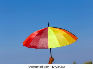multicolored umbrella on green grass background