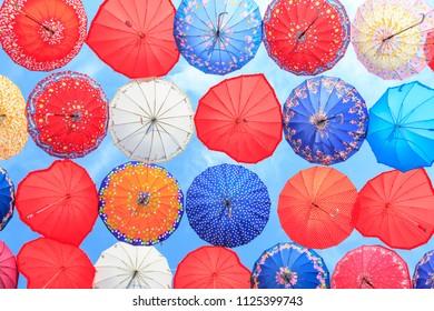 Multicolored umbrellas against the blue sky in Kemer, Turkey