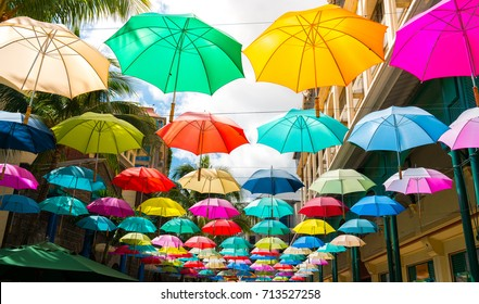 multicolored umbrellas in le caudan waterfront, port louis capital of mauritius