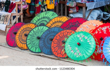 Multi-colored umbrellas in the local market in Bagan, Myanmar. Copy space for text