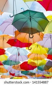 A lot of multicolored umbrellas over the sky