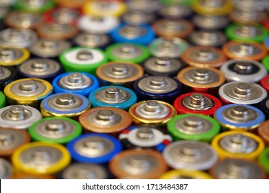 A lot of multicolored used batteries
