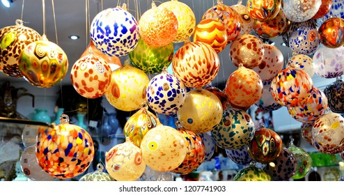 multicolored venetian balloons made of glass decorating a vitrine