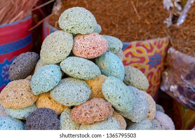 Multicolored volcanic pumice in the eastern bazaar. Pumice sale for body care in the market. Pumice stone for beauty care.