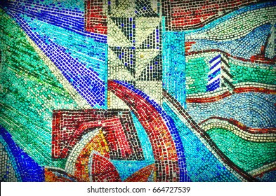 Multicolored wall of a house of colored mosaic