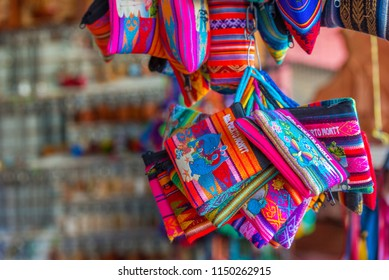 Multicolored wallets in the store, Puerto Montt, Chile. Close-up