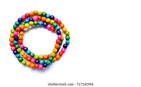 Multicolored wooden beads on a white background. Wooden necklace beads isolated