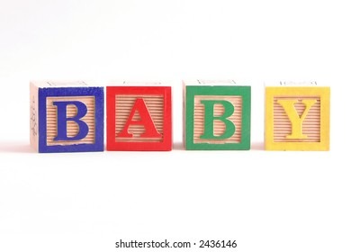"""Multi-colored wooden blocks spelling the word """"Baby"""" horizontally.  White background, isolated."""