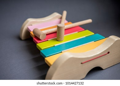 multi-colored xylophone on a dark background