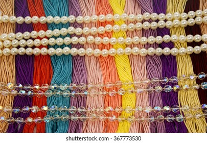 Multi-colored yarns. Floss with beautiful multicolored pearls and glass beads brilliant,creative and embroidery.