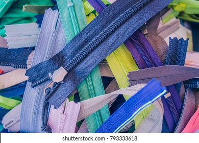 Multicolored Zippers or Zip Fasteners used for binding fabric or textile. Colorful Clasp Lockers Background or Pattern concept of Clothing Industry, Secret Keeper, Truth Revealing, Adhesion, Adherence