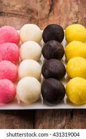 Multicolour dry Rassgulla or Rosogullas and Chamcham and Kala jamun - popular bengali sweets