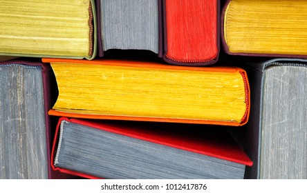Multi-coloured books from above. The Close up.
