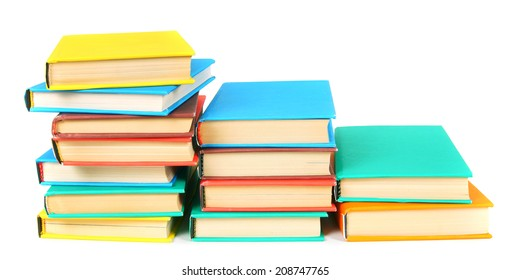 Multi-coloured books. On a white background.