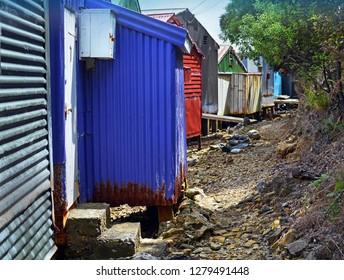 Multi-coloured corrugated iron boat sheds at Waikawa Bay, Picton, New Zealand