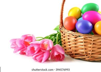 Multicoloured Easter eggs in basket isolated on white
