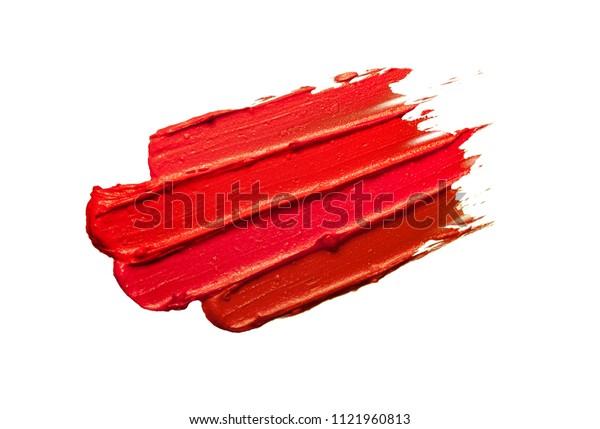 Multicoloured lipstick smudge black isolated background