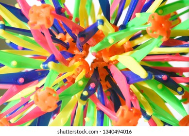 Multi-coloured pieces of bright plastic with shallow depth of field and vibrant colours of the pollution material