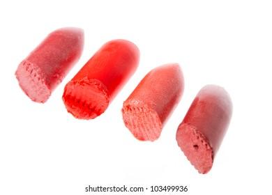 Multicoloured scraps of lipstick isolated on white background