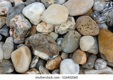 Multicoloured stones and pebbles on a beach