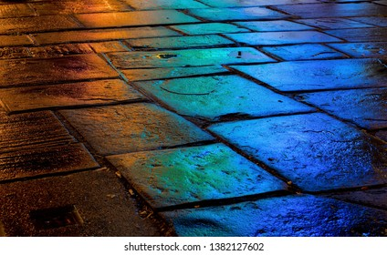 multicoloured street cobbles at night in coloured lights