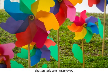 Multicoloured windmill toys in the garden