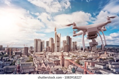 multicopter drone flying over the cityscape of Frankfurt am Main, Germany, financial capital of the european union