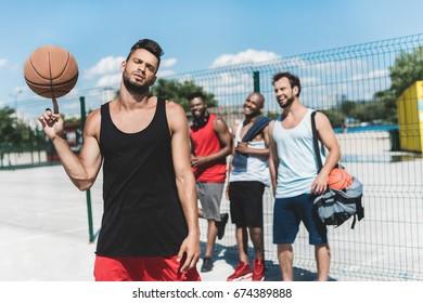 multicultural basketball team spending time on basketball court