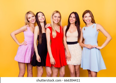 Multicultural beauty, fashion and woman concept. Five cute ladies in colorful short cocktail dresses are ready for night out party, so pretty and attractive, fashionable and trendy!