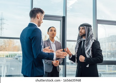 multicultural businesspeople discussing work on meeting with translator in modern office